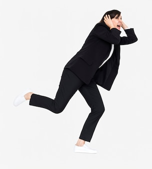 Stressed businesswoman running away from a crisis