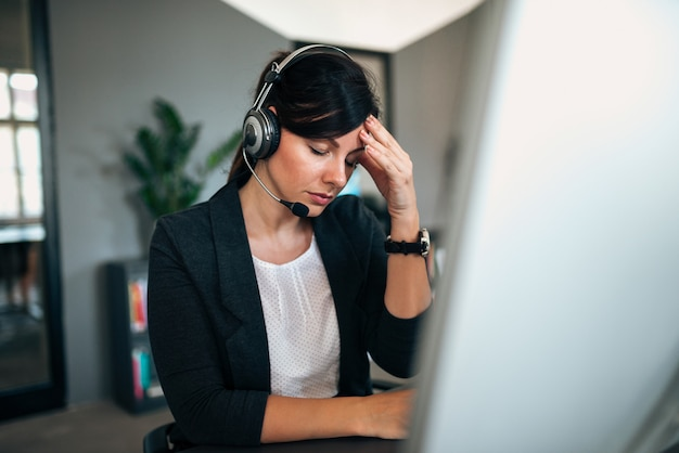 Stressed female call centre employee.