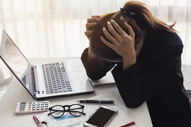 Stressed and frustrated asian business woman