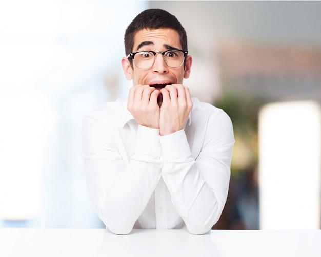 Stressed man biting his nails