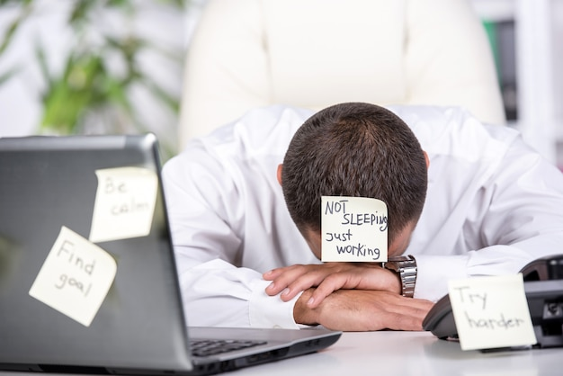 Stressed man is looking online for a job.