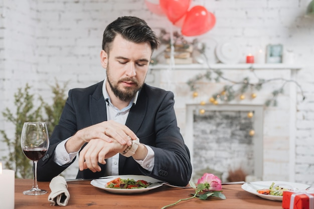Stressed man waiting for date being late