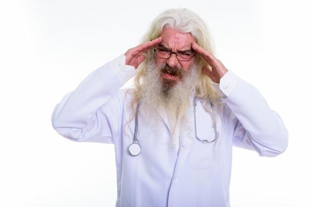 Stressed senior bearded man doctor having headach
