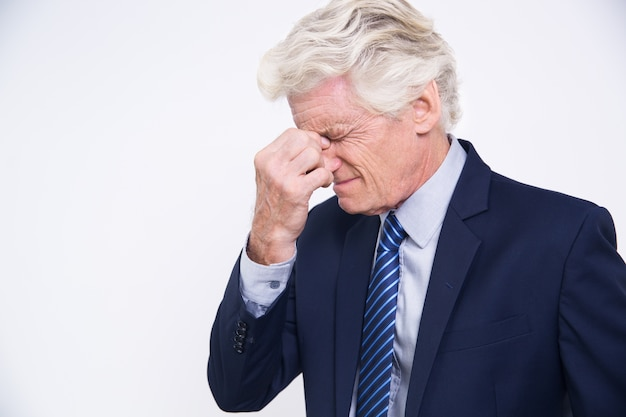 Stressed senior caucasian businessman rubbing eyes