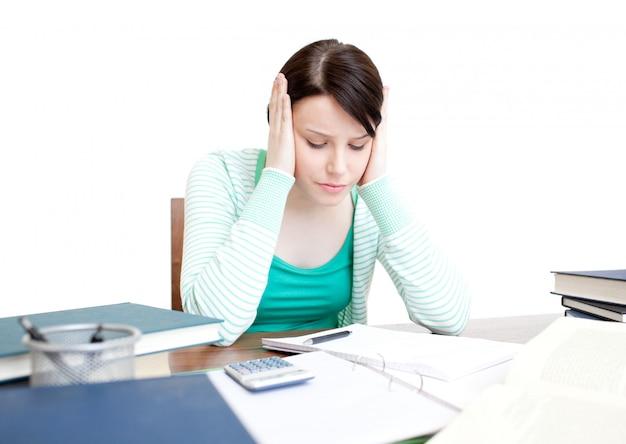 Stressed student doing her homework