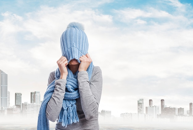 Stressed woman covering her head with a knit cap