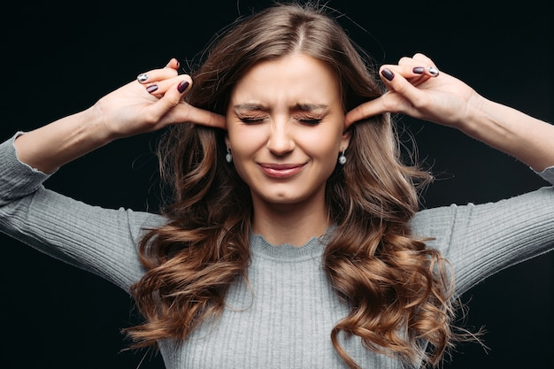 Stressed woman feeling negative emotions isolated on gray background