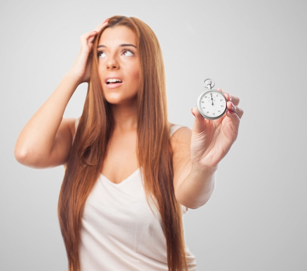 Stressed woman with stopwatch in hand