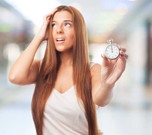 Stressed woman with stopwatch