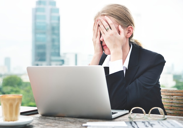 Stressed woman working on her laptop