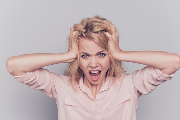 Stressed woman yelling desperate touch head crazy expression