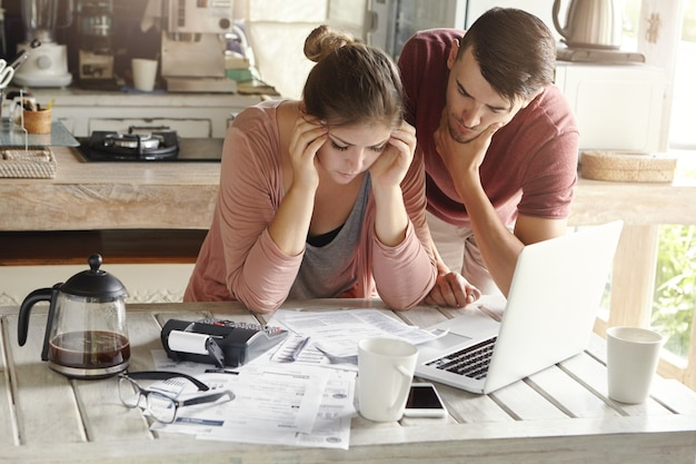 Stressed young caucasian couple facing financial problems
