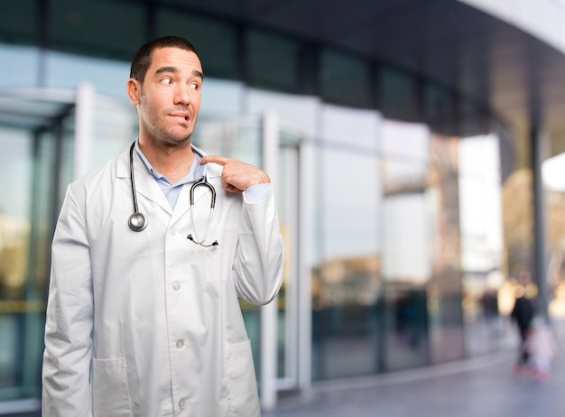 Stressed young doctor with a gesture of ansiety