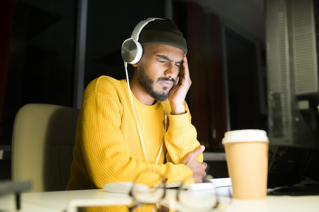 Stressed young man at work