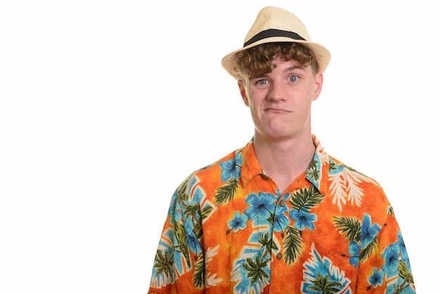 Stressed young tourist man with hat looking upset for vacation