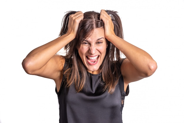 Stressed young woman on white background