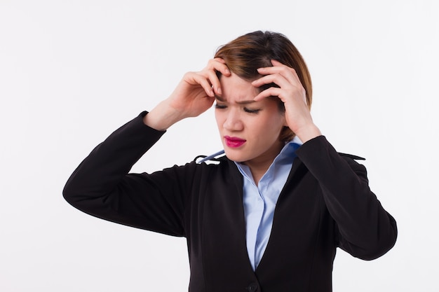 Stressful business woman suffers from headache