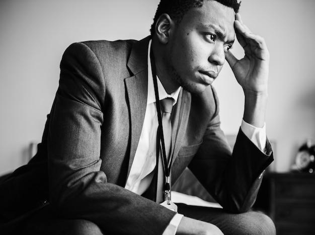 A stressful man alone in a room