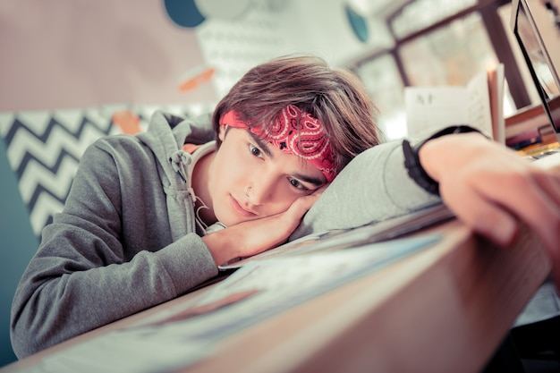 Stressful period. the tired student almost sleeping on the desk