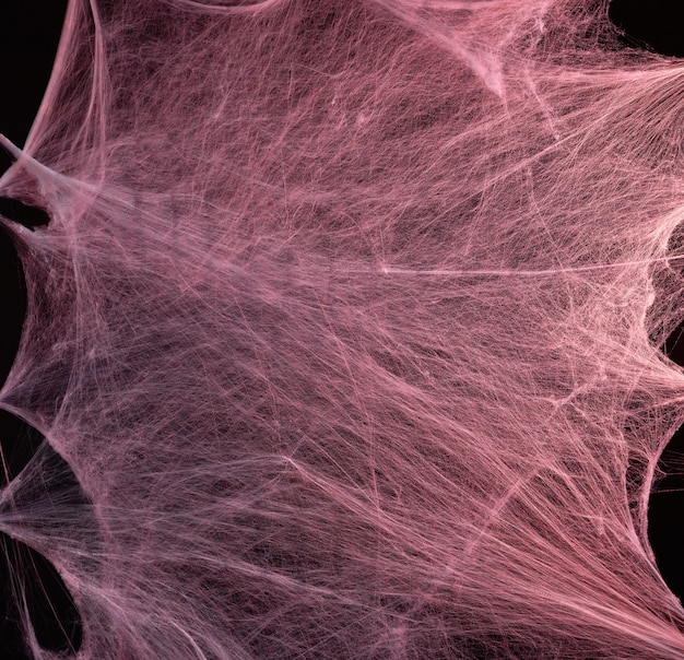 Stretched white web with red backlight, background for the holiday halloween
