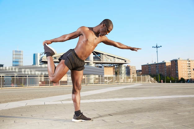 Stretching in urban environment - adult afroamerican ethnicity