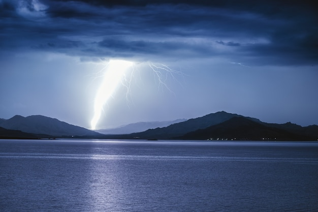 Strike of lightning on a mountain lake