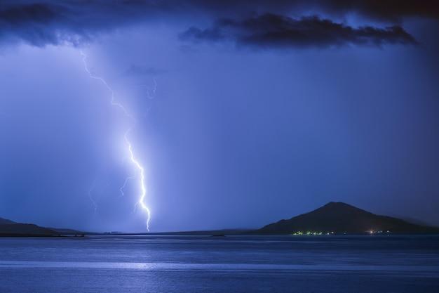 Strike of lightning on a mountain lake
