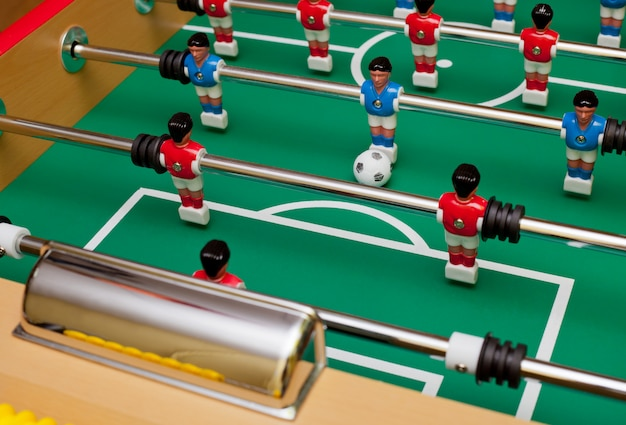 Striker in table football, aim at the goal.