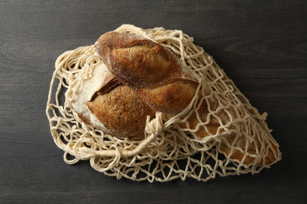 String bag with bread on black