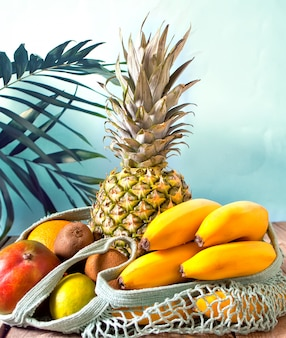 String bag with organic tropical fruits. shopping food with eco friendly bag. zero waste and recycling concept.