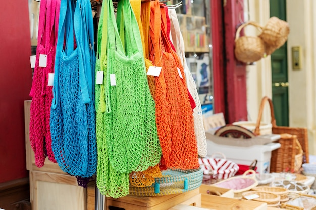 String bags. store with many different colors string bags, basket. no plastic, zero waste concept store. recyclable reuse shopping bags in eco friendly environmental protection shop.