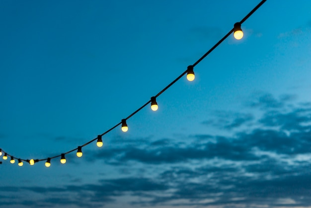 String of lights with sunset sky