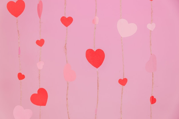 Strings composed of hearts on a pink background