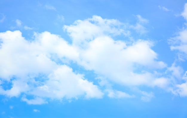 Strip of clouds in the blue sky, may be used as background