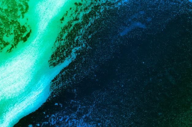 Stripe of foam on gradient colored liquid