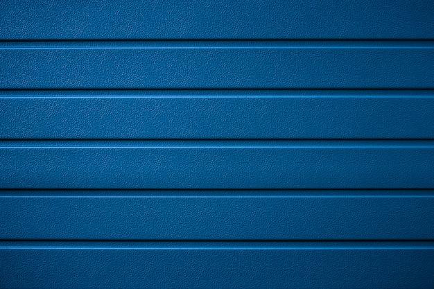 縞模様、クラシックなブルーの金属の質感。光沢のある表面、行構造、リブ付きの背景。