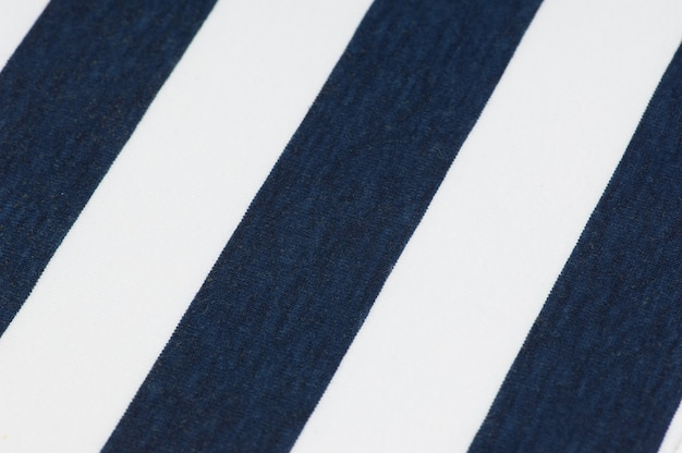Полосатый фон из ткани и текстиля синего и белого цвета