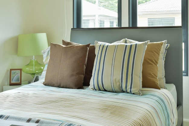 Striped bedding in modern decorated bedroom