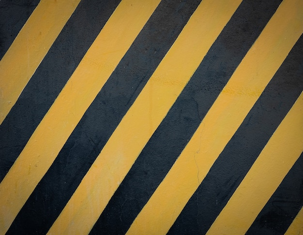 Striped black and yellow grunge background.