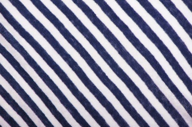 縞模様の布。水平方向の青い縞模様。服の船乗り。バックグラウンド。テクスチャ。