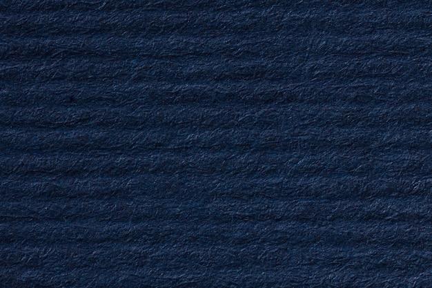 Striped dark blue paper background. high resolution photo.