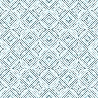 縞模様の手描きパターン。青い対称的な万華鏡の背景。縞模様の手描きのタイルを繰り返します。テキスタイルレディエクストラプリント、水着生地、壁紙、ラッピング。 Premium写真