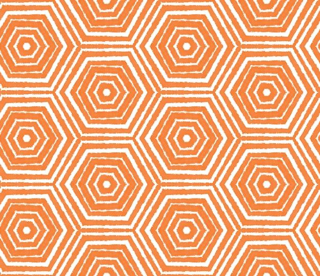 縞模様の手描きパターン。オレンジ色の対称的な万華鏡の背景。縞模様の手描きのタイルを繰り返します。テキスタイルレディアライブプリント、水着生地、壁紙、ラッピング。