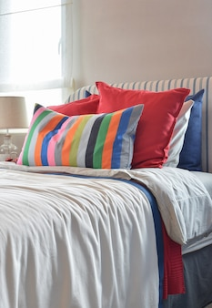 Striped headboard with colorful pillows