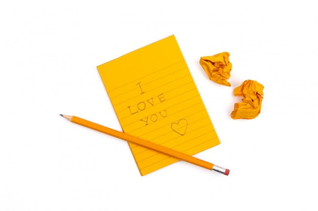 A striped notebook with orange sheets and 'i love you' text w