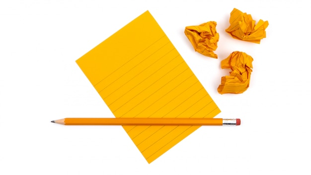 A striped notebook with orange sheets