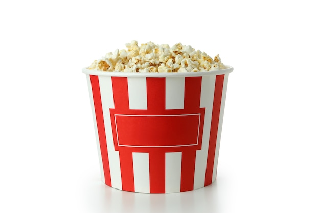 Striped paper cup with popcorn isolated on white background.