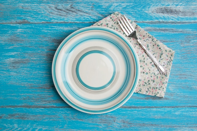 Striped plate on wood background