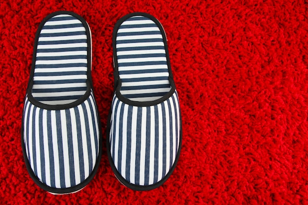 Striped slippers on carpet