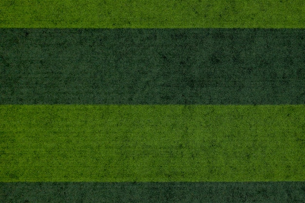 Striped soccer field background, green grass soccer field background